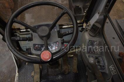 Экскаватор колесный Hitachi EX125WD-5 1999 года в Японии