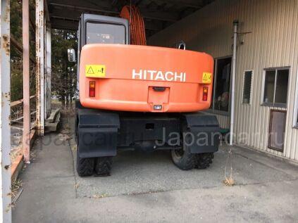 Экскаватор колесный Hitachi EX125WD-5 2003 года во Владивостоке
