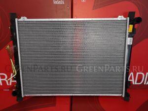 Радиатор двигателя на Kia Carens UN