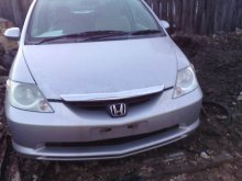 Тросик багажника HONDA FIT ARIA GD9 L15A