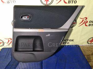 Обшивка двери на Toyota Vitz KSP90