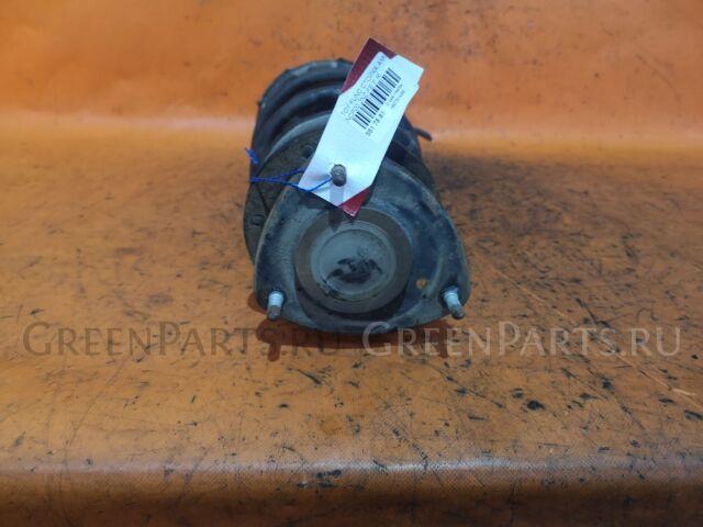 Стойка амортизатора на Toyota Funcargo NCP20, NCP21