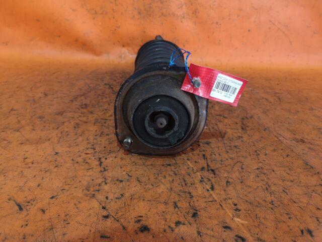 Стойка амортизатора на Mazda 121 DW