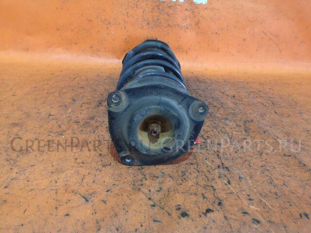 Стойка амортизатора на Nissan Micra AK12, BK12, K12