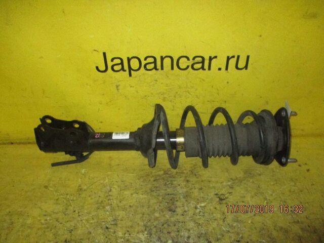 Стойка амортизатора на Toyota Vitz SCP10 1SZ-FE