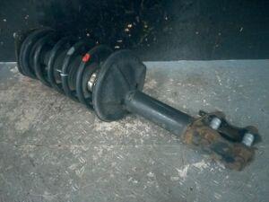 Стойка амортизатора на Toyota Raum EXZ15 5E-FE