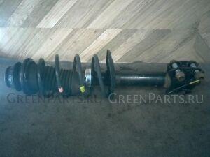 Стойка амортизатора на Toyota Vitz KSP90 1KR-FE